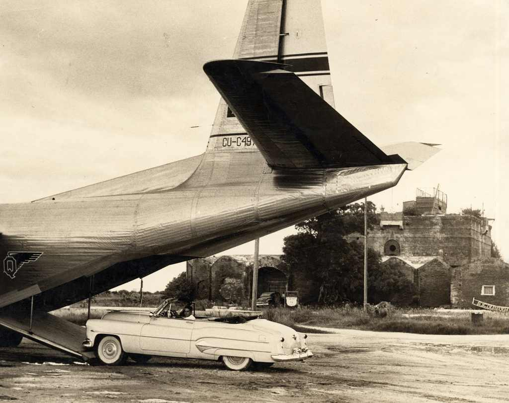 A Cadillac being driven in the back of an Aerovias Q plane at the Key West International Airport C 1950s. From the Key West Art and Histoical Society Collection. Photo: http://www.flickr.com/photos/keyslibraries/8091206967/sizes/l/