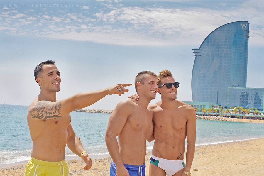 Handsome man on beach in Barcelona for MyGayPride with Two Bad Tourists, ManAboutWorld gay travel magazine