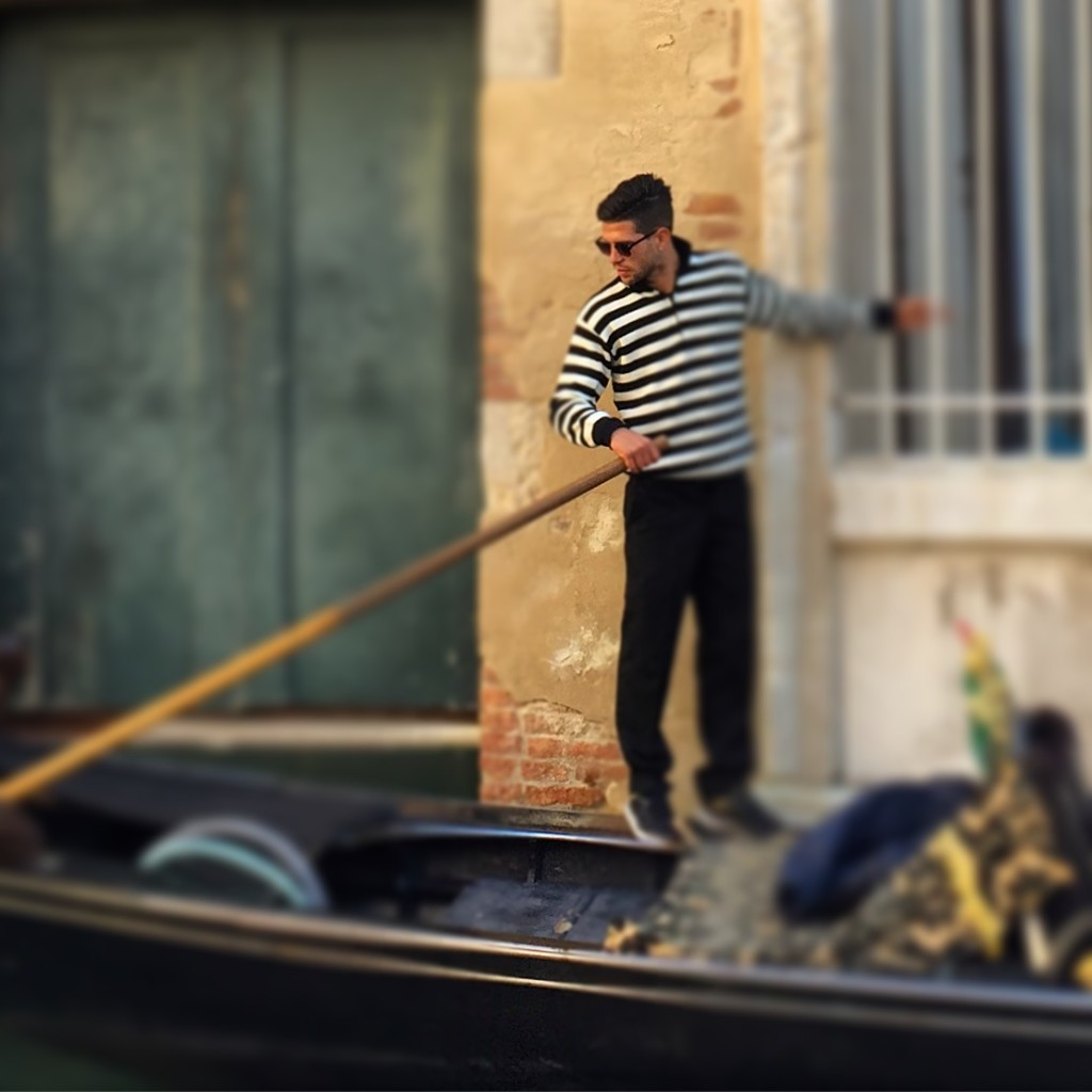 A dashing gondolier in Venice and in ManAboutWorld gay travel magazine