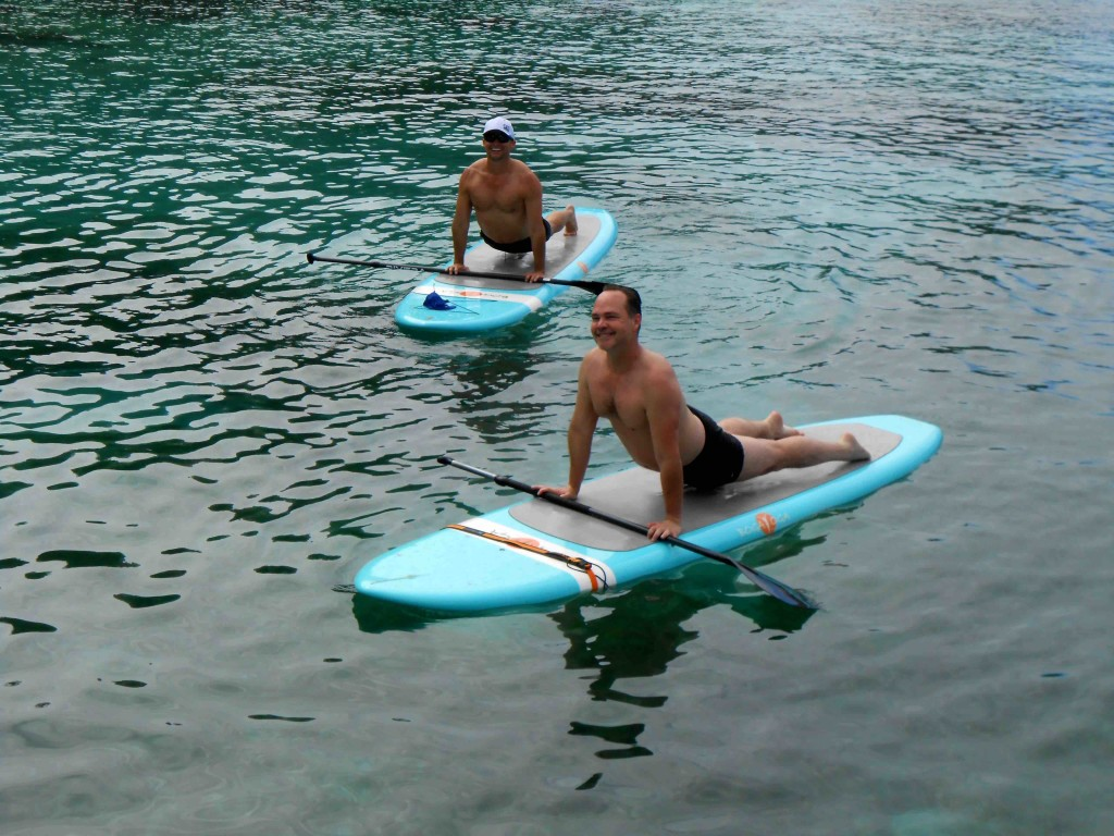 Yoga paddleboard requires balance, strength and focus, as seen in ManAboutWorld gay travel magazine