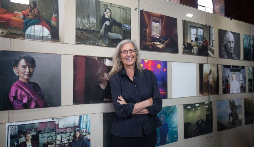Annie Leibovitz, portrait photographer, poses with her photographs on display at the launch of WOMEN: New Portraits exhibition at Wapping Hydraulic Power Station in London, U.K., on Wednesday, Jan. 13, 2016. The international touring exhibition, commissioned by UBS, will be in London from Jan. 16 until Feb. 7. Photographer: Simon Dawson/Bloomberg via Getty Images