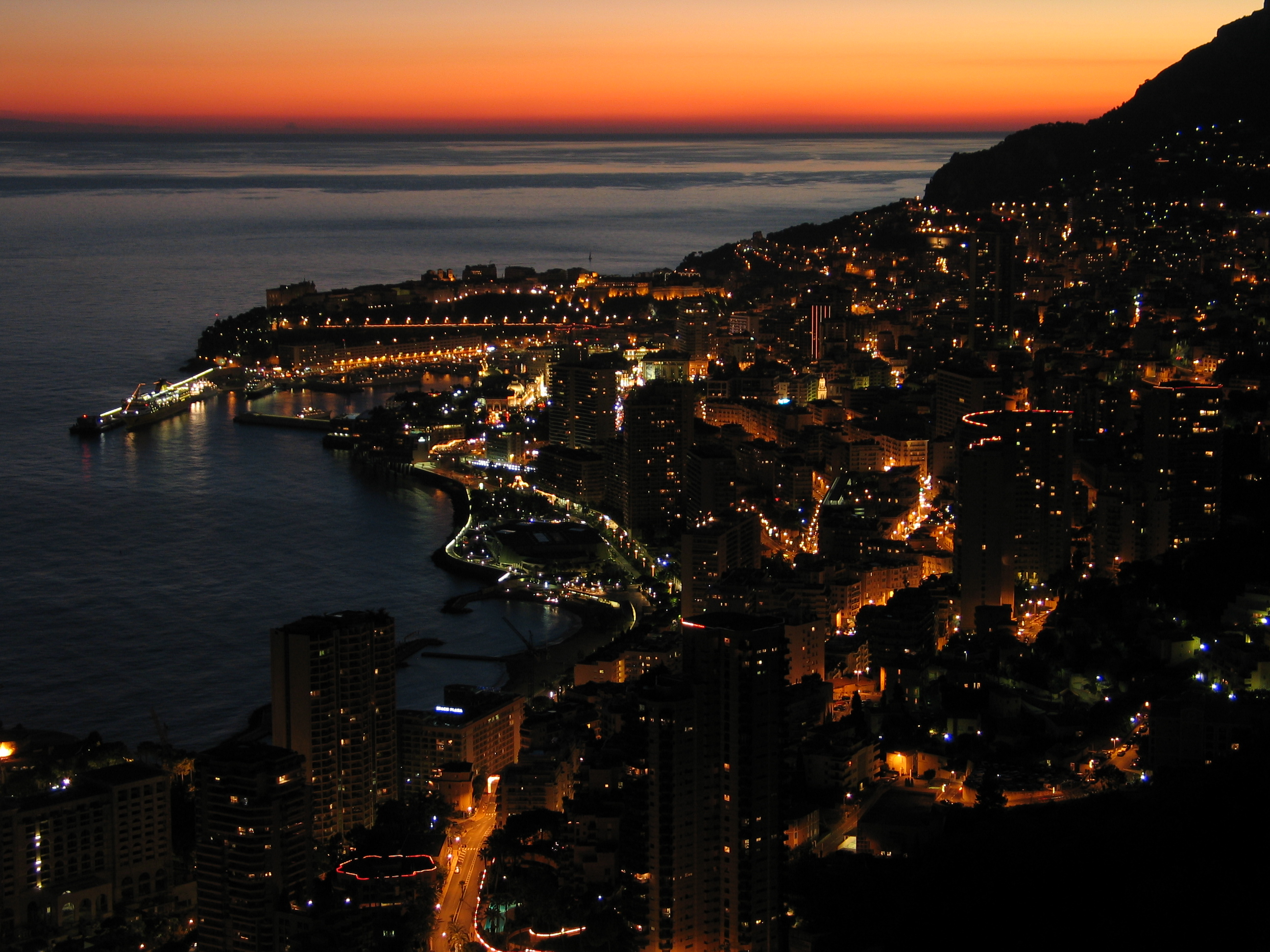 The evening glow of Monaco's Riviera coastline