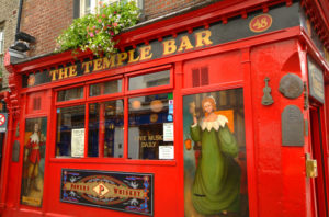 The Temple Bar Pubfront in close up with artwork of medieval characters in Ireland with Brendan Vacations