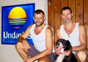 The owners of the beach at the gay-only Undarious Hotel in Uruguay and in ManAboutWorld gay travel magazine