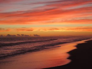 Sunset on the beach at the gay-only Undarious Hotel in Uruguay and in ManAboutWorld gay travel magazine