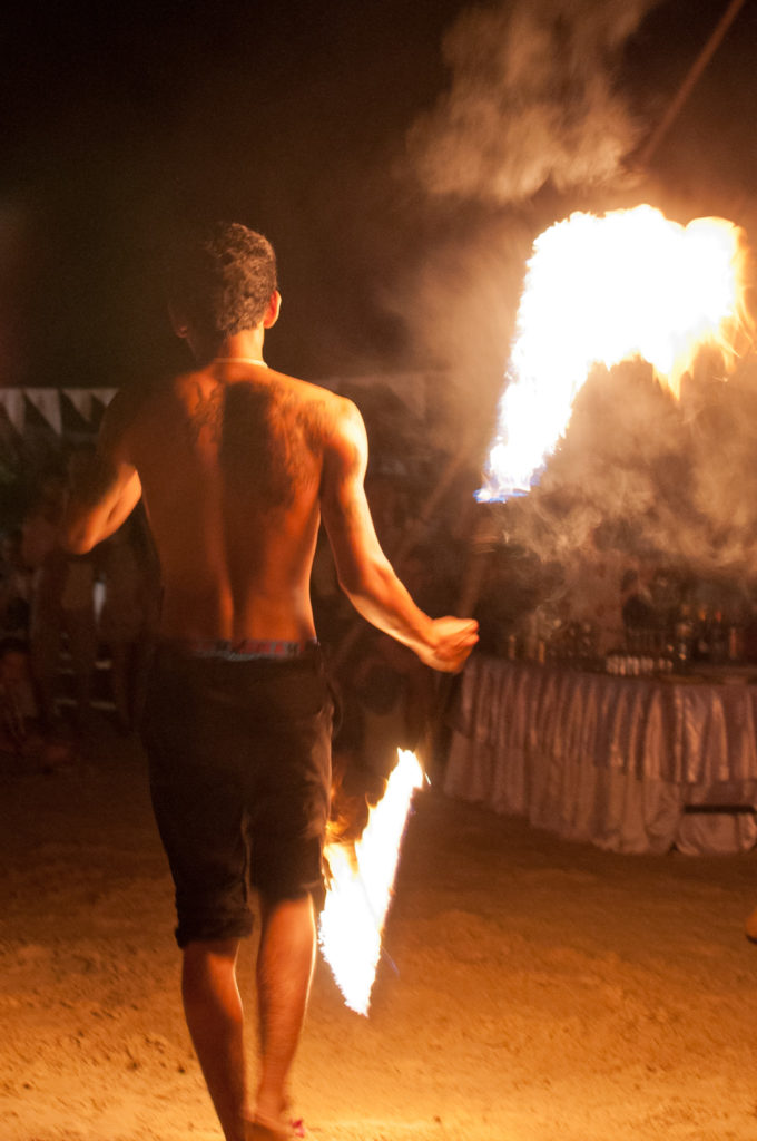 Fire juggler in ManAboutWorld gay travel magazine; meet him in Thailand using one of our Thailand gay travel experts