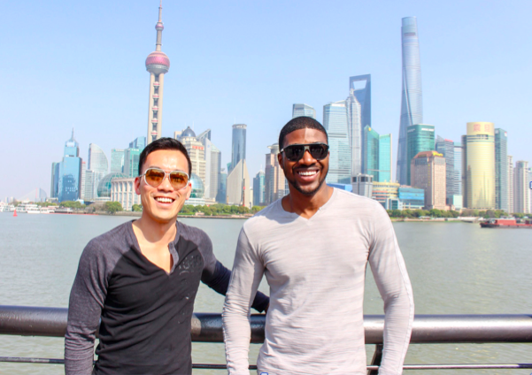 Barry Hoy and his partner with Shanghai in the background in ManAboutWorld gay travel magazine